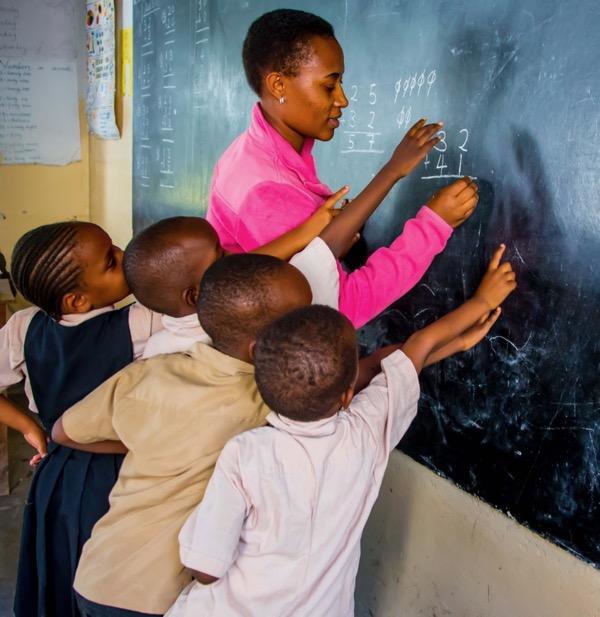 teacher and kids at blackboard